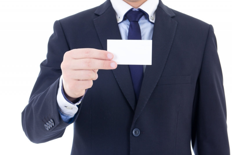 10626711-business-card-in-male-hand-isolated-on-white